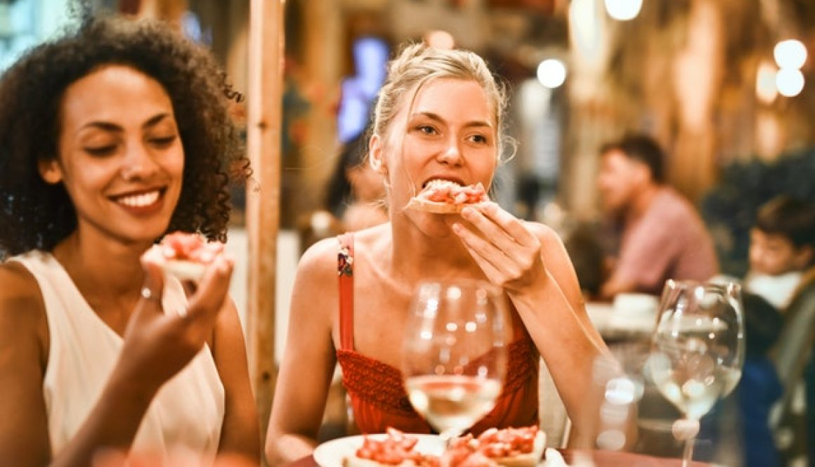woman-eating-bruschetta-1537635
